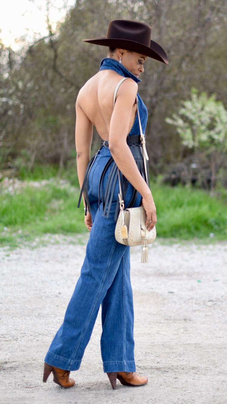 Denim Jumpsuit | Fringe waist cinch belt | Cowboy hat | Frye ankle boot | Lauren Ralph Lauren Shoulder bag Posted by Vivellefashion