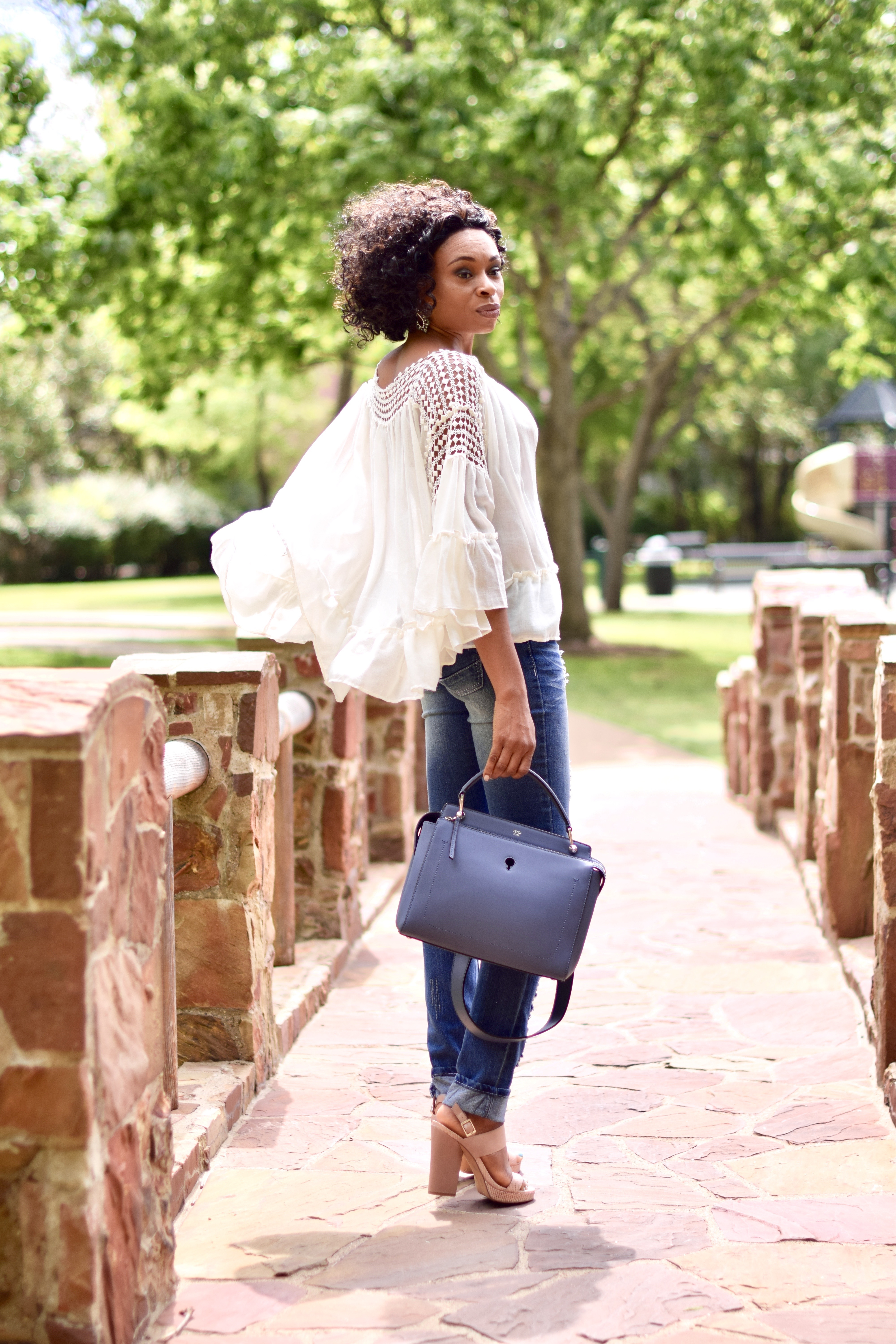 Monochromatic look-ruffle top + destructed jeans posted by vivellefashion