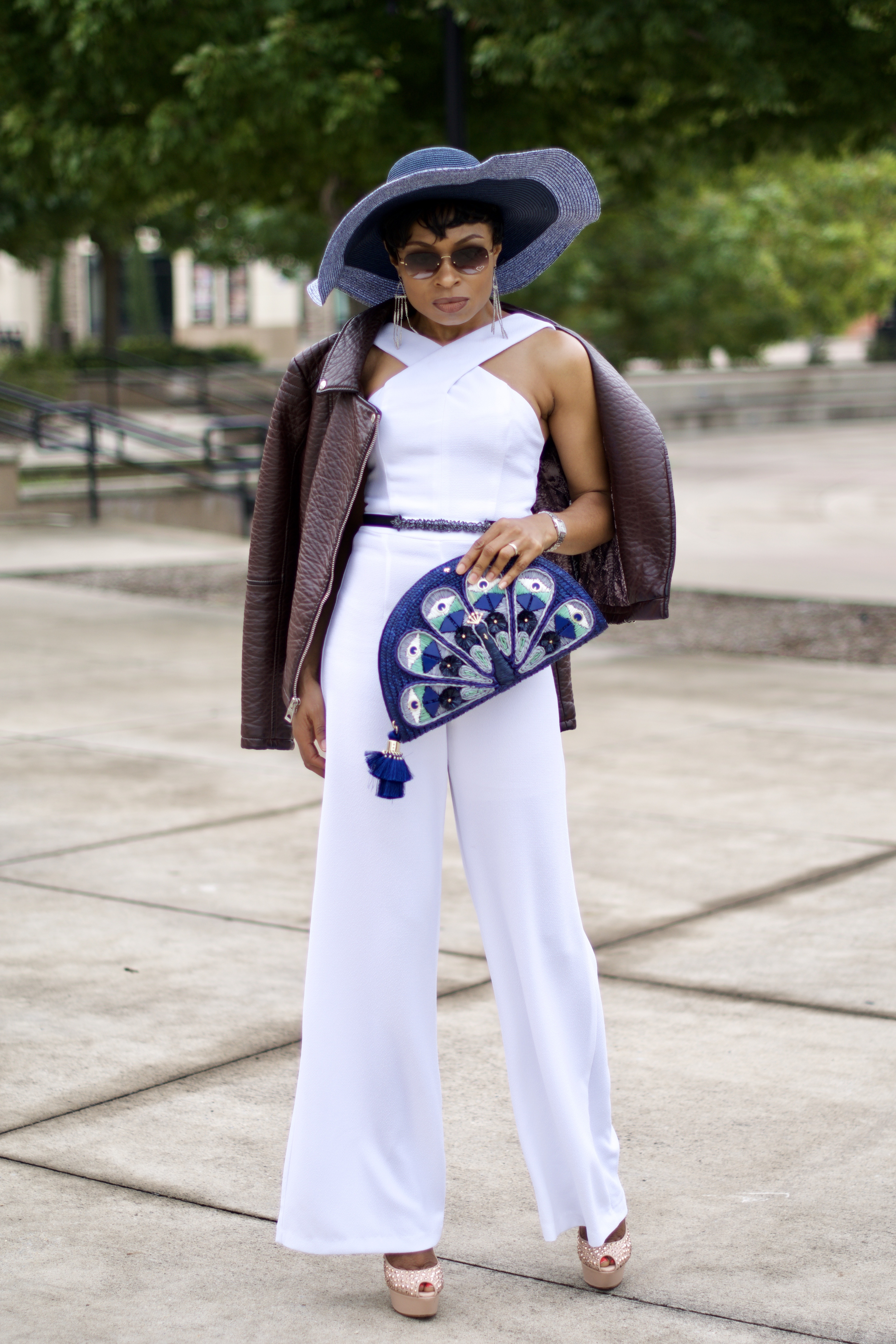 White Jumpsuit + Kate Spade Peacock Clutch
